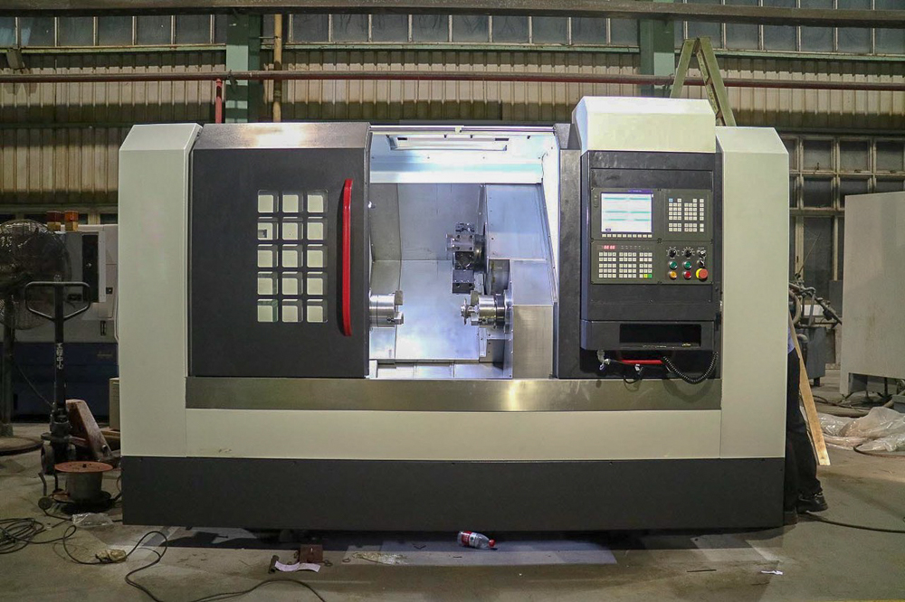 "DSTT-40 & DSPTT-40 Dual Spindle/Twin Turret CNC Turning Center: 12-Station Stactic Tool Turret or Power Drive Tool Turrets: 2"" or 1-3/4"" Spindle Bore, A2-6 or A2-5 Spindle Nose"